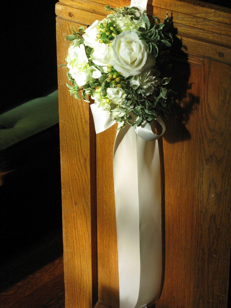Elegant arrangement of miniature variegated ficus, hypericum berries and beautiful cream-colored roses,