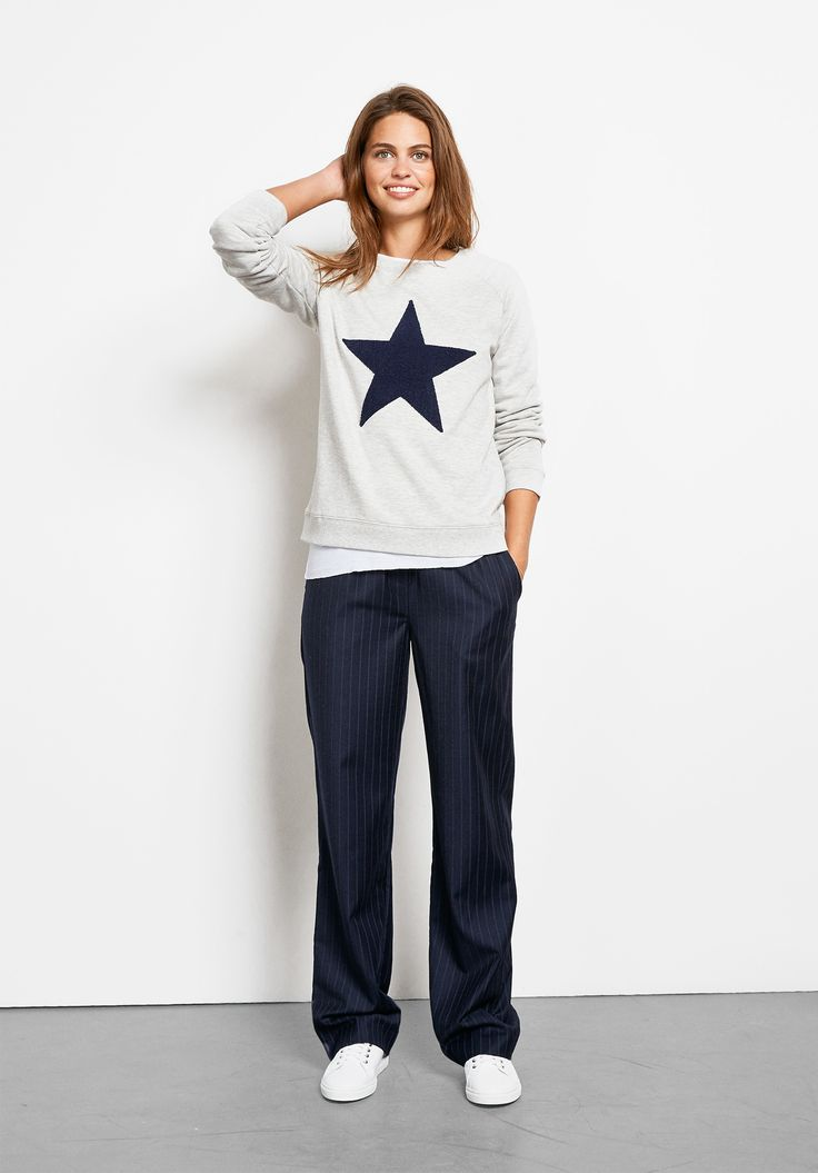 """Sweatshirts are one of our favourite off-duty pieces to wear, as are star motifs! So this top is a must for your wardrobe for ultra downtime chic. • Length 61cm (size S). • Model is 5'9"""" and wears size S."""