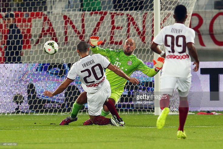 Goalkeeper Pepe Reina of Muenchen makes a save against Hamdi Harbaoui of Qatar Stars