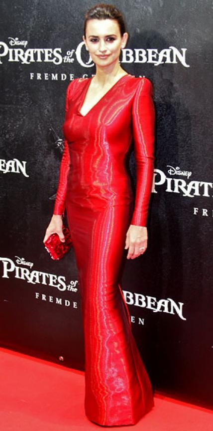 MAY 17, 2011 Penelope Cruz WHAT SHE WORE In Munich, the Pirates of the Caribbean: On Stranger Tides actress sizzled in a scarlet Armani Prive gown and matching box clutch.