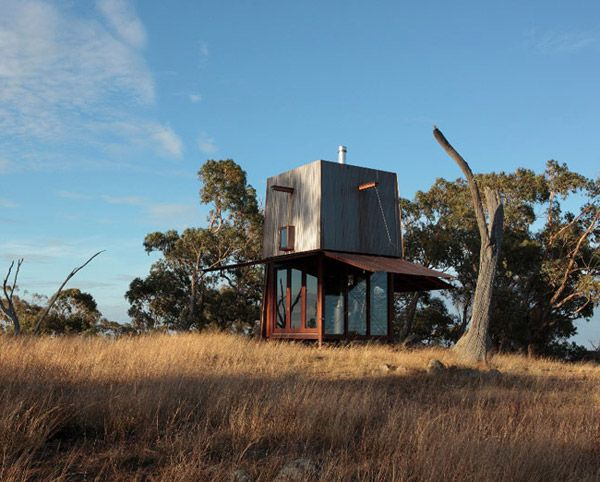Tiny House Design in the Australian Outback    A tiny treasure in the Australian outback, this cool, tiny house design by Australia architects Casey Brown Architecture brings a bit of the unexpected into its natural surroundings. This prefab cottage measures only 10 by 10 ft., clad in copper with a glass-enclosed lower level revealed when the shades are drawn.