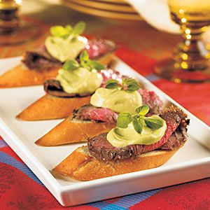 For an appetizer that tastes just as good as it looks, this steak crostini is a definite must-serve. The grilled flank steak pairs beautifully with the avocado and wasabi spread. Add a sprig of oregano on top and you'll get a pop of color and a pretty presentation.