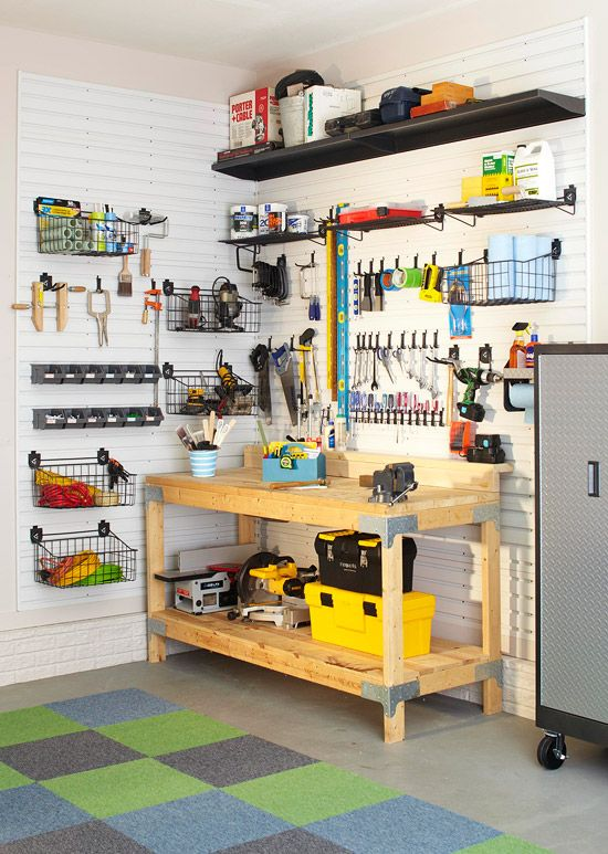Workshop Zone  Keeping a garage workshop is a job in itself. Overcome that obstacle by enlisting wall space to mount small bins and tool racks around your workstation. Slatted wall panels surround the wall space around this workbench to make storing tools easy and efficient.