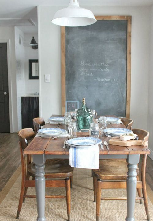 Gray dining room table with wood top. Love the large chalkboard in the space too.
