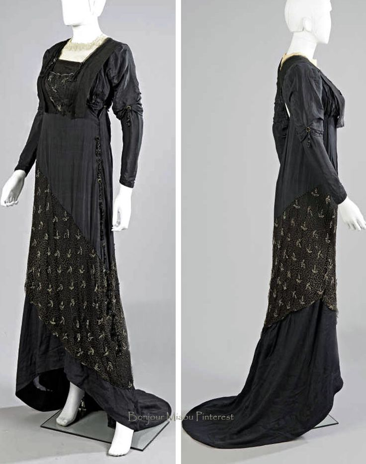 Dress, Marie Chapot, Turin, ca. 1900-10. Black silk crêpe, gauze, and tulle embroidered with gold metallic thread and trimmed with beads and jet in a floral pattern. Guipure lace on round neckline; beaded tassels on each side. Left side of skirt forms short train. Millon Auctions via PB Fashion Expert