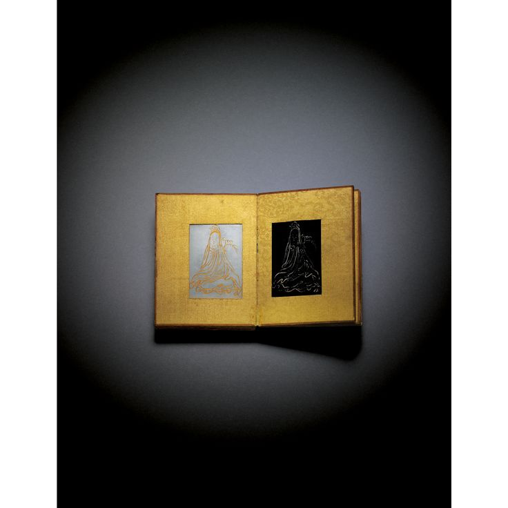 """Prajnaparamita Sutra ('Heart Sutra')  - an inscribed Celadon Jade book of the Qing dynasty, Qianlong period; panels set into pages of yellow silk brocade; the book is the smallest known example at only 3"""" high. It was made for the Qianlong Emperor, the inscriptions being facsimiles of his handwriting.  [chinese works of art 