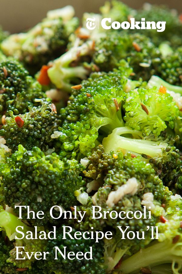 "This salad is made from uncooked broccoli tossed with an assertive garlic, sesame, chile and cumin-seed vinaigrette slicked with good extra-virgin olive oil and red wine vinegar. The acid ""cooks"" the florets a little as ceviche does fish. After an hour, the broccoli softens as if blanched, turning bright emerald, and soaking up all the intense flavors of the dressing. You'll be making this one again. (Photo: Danny Ghitis for The New York Times)"