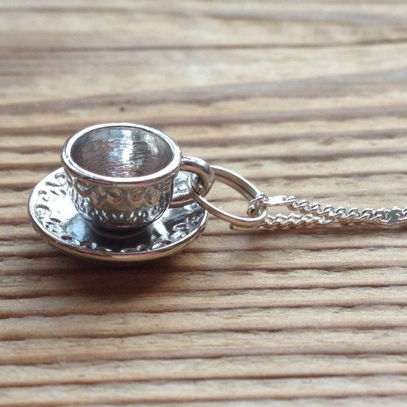 Tea cup charm necklace on a fine silver chain with a lobster clasp. This tea cup necklace is perfect for a tea lover and comes beautifully packaged in an organza bag so is great for giving as a gift. For any tea lovers who are planning a wedding, these would also be lovely for bridesmaid gifts! A cup of tea is never far from my side so I couldnt resist making this tea cup necklace, in fact I probably had a cup of tea next to me whilst making this! Everything in my shop has been lovingly…