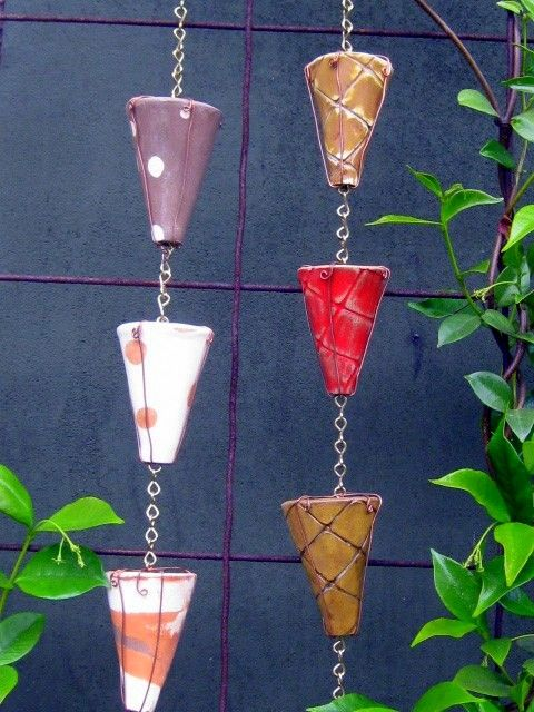 Ceramic pottery cones ~~ make for a colourful rain chain on Etsy which probably also makes a beautiful sound. The cones are no longer available, but would be fun to make something similar.