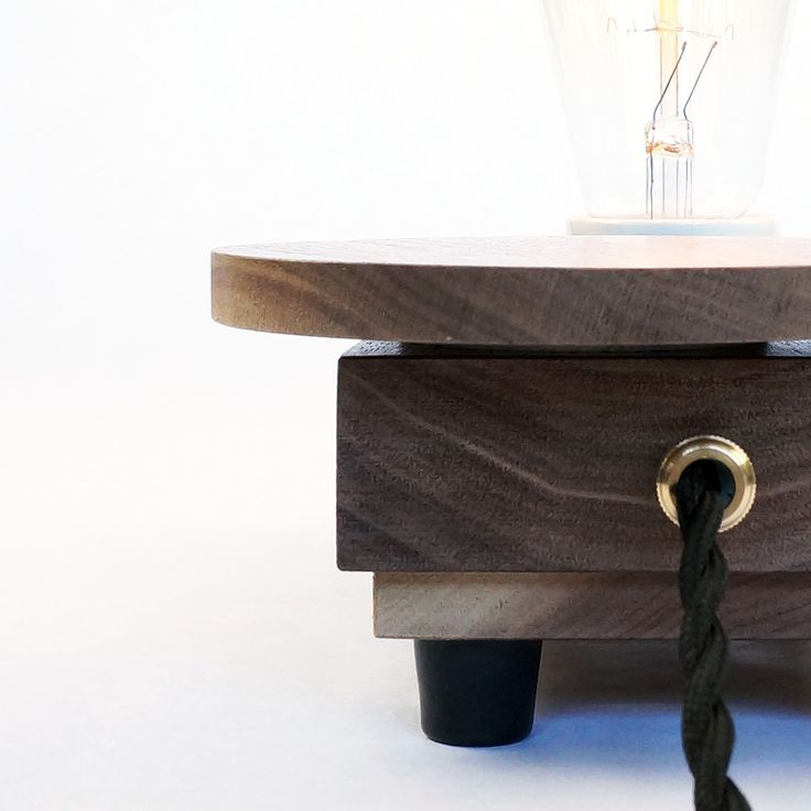 Lamp 'Disc' rev.01 | Unique table lamp handcrafted in small series with 'sealed' Walnut wood. The horizontal disc operates the dimmer and switches the lamp on/off. #industrialdesign #design #deco #light #lighting #lamp #tablelamp #edison #woodwork #wood #handmade #handcrafted #unique #exclusive #Zzz #filament #hip #authentic #woodworking #minimalist #minimalism #1900s #moderndesign #productdesign #walnut #style