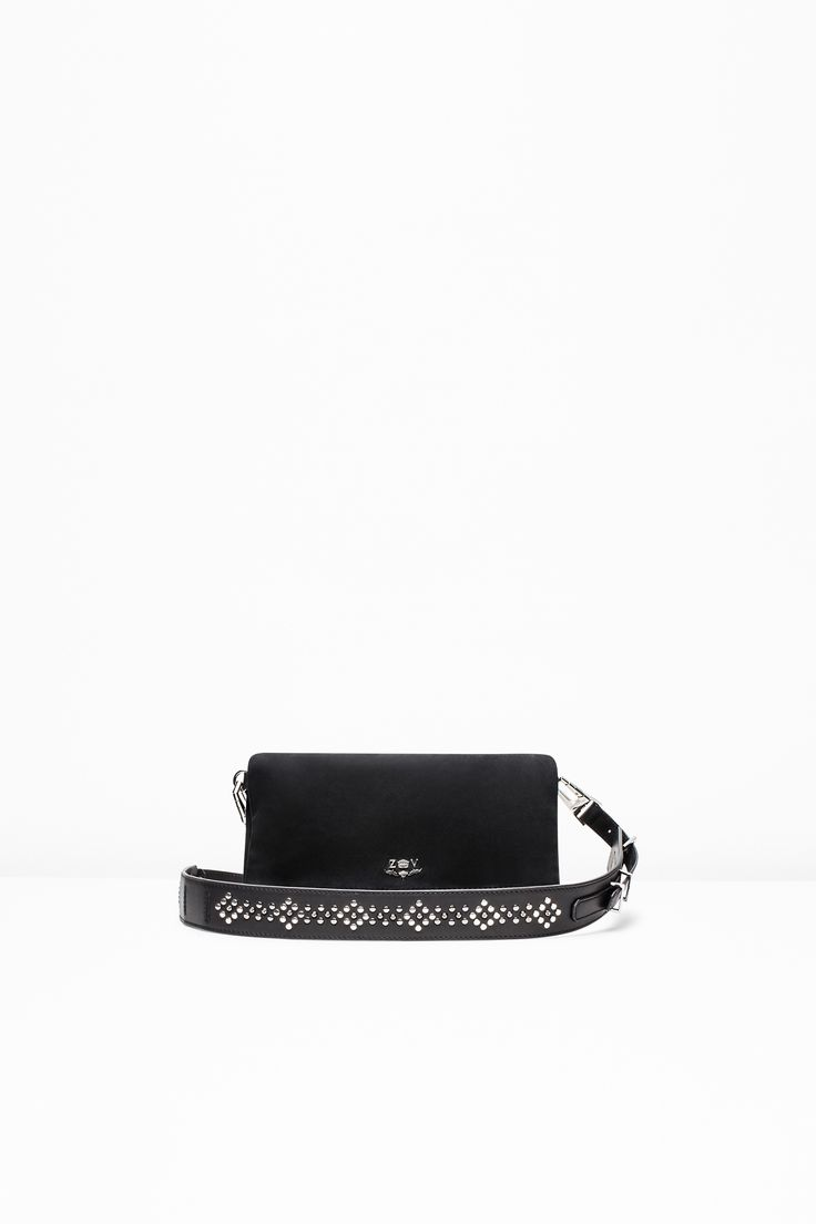 "Zadig & Voltaire zip clutch, shoulder strap, ZV badge, 2x18x27cm/0.75x7x10.5"", 100% smooth and suede leather. The emblematic Rock Clutch has been updating its look for more than ten years. With its sophisticated and dynamic style, it's perfect day or night. This guitar strap-inspired version features a wider shoulder strap with a studded design."