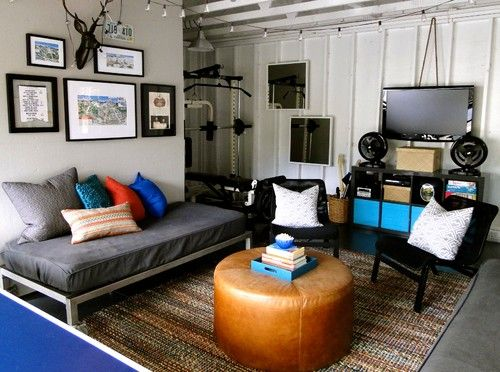Garage Redesigned to Teen Hangout Space. The flat bed/couch concept seems smart. And the rug works well, too.: