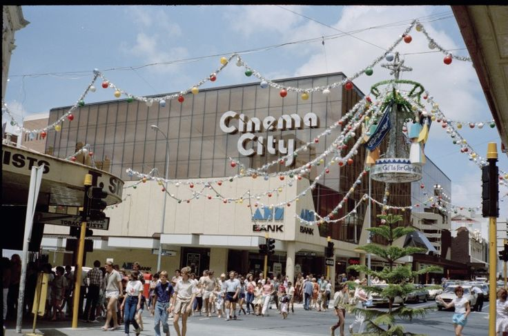 311666PD: Christmas decorations at the intersection of Hay and Barrack Streets, Perth, December 1982 https://encore.slwa.wa.gov.au/iii/encore/record/C__Rb3939538