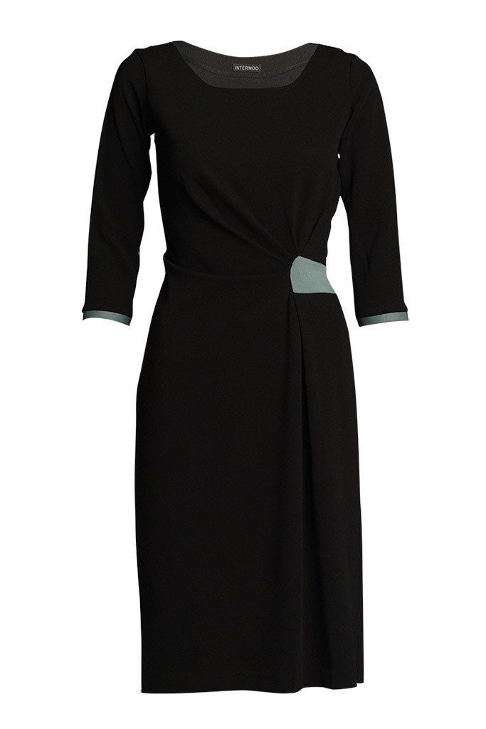 Black Beam Draped Work Dress. Delicately placed pleats tending to the waist, finished off by the beautiful colored panel. Defines the waist and creates a slimmer hip silhouette.