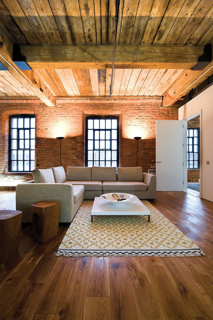 We love the original features in this beautiful loft in Manchester, England #heritage #interiordesign