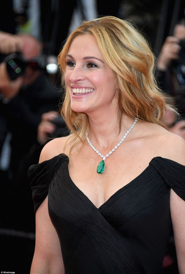 Statament jewel: The Pretty Woman star jazzed up her sombre gown with a stunning emerald pendant set off on a dazzling diamond chain