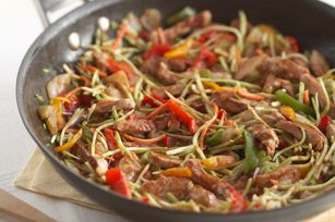 Rush-Hour Pork Stir-Fry recipe:  Every commuter's dream come true: a low-cal, low-fat dish that's full of flavor and veggies, and can be ready in less than 25 minutes. That's cookin' in the fast lane.