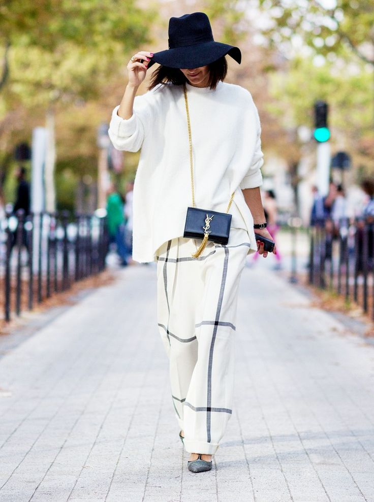 Black hat, oversized white knit, YSL bag & baggy grid print trousers #Streetstyle #PFW #Style #Fashion