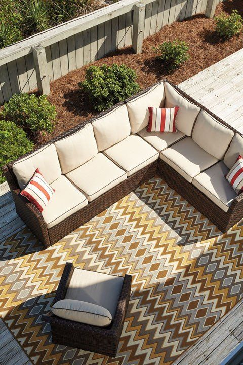 ashley furniture outdoor peckham park sectional includes two loveseats corner and ottoman all on a rust free aluminum frame with resin wicker
