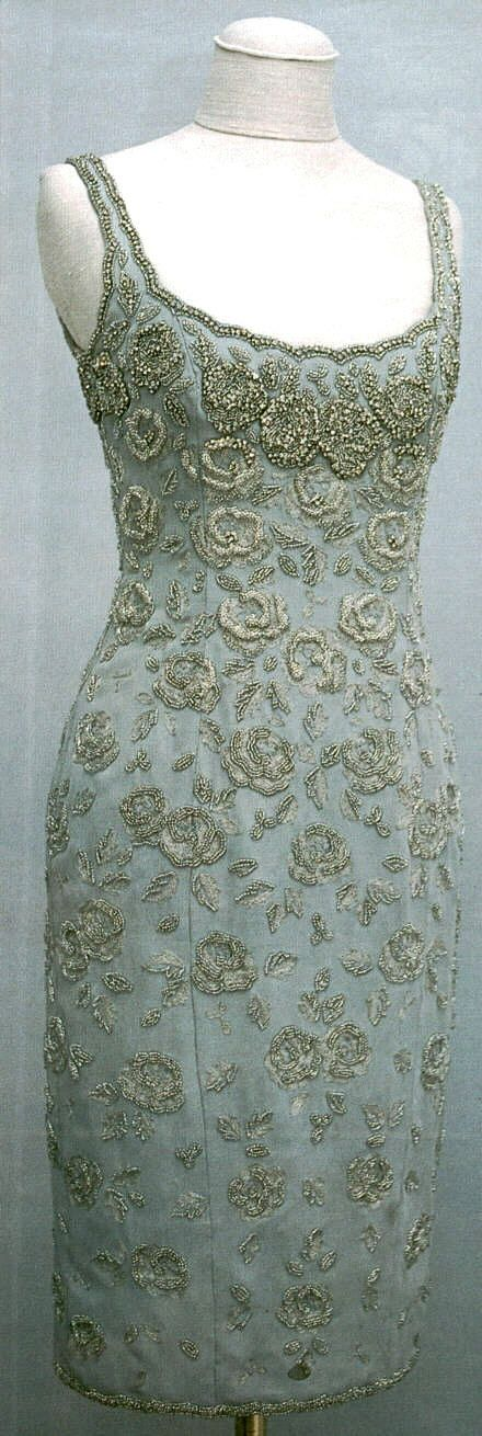 Diana attended the preview of the Christie's sale of her evening dresses wearing Catherine Wallker's ice blue Taroni silk crepe shift dress with silver embroidery