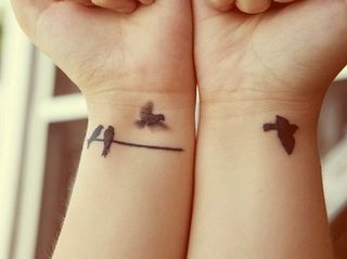 Bird tattoo to consider.  I like the 2 on the branch.