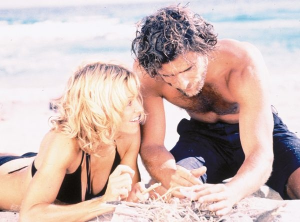 SWEPT AWAY  While on a Mediterranean cruise, a storm leaves a wealthy woman (Madonna) shipwrecked on an island with her ship's Italian first mate. While working together to survive, the two can't help putting their differences aside and falling in love each other. Swoon.