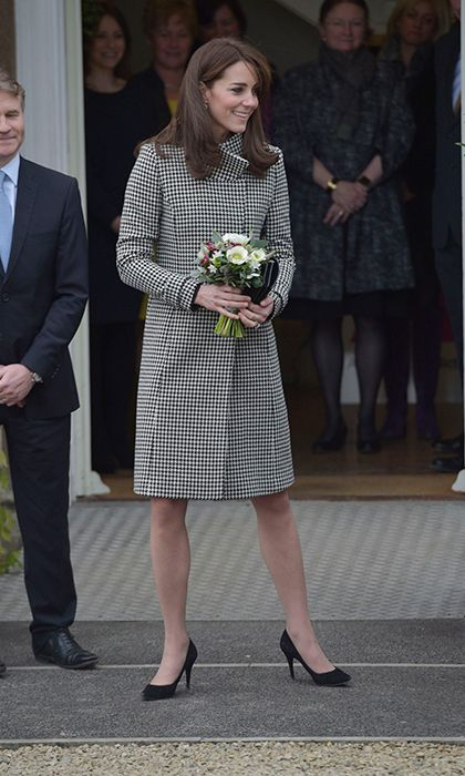 The Duchess of Cambridge looked chic in her Reiss 'Rubik' houndstooth coat for a charity visit in Wiltshire, England.