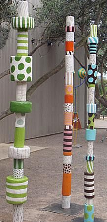 campus art. Not known what campus but after looking at web site found that these totems are ceramic not wood.