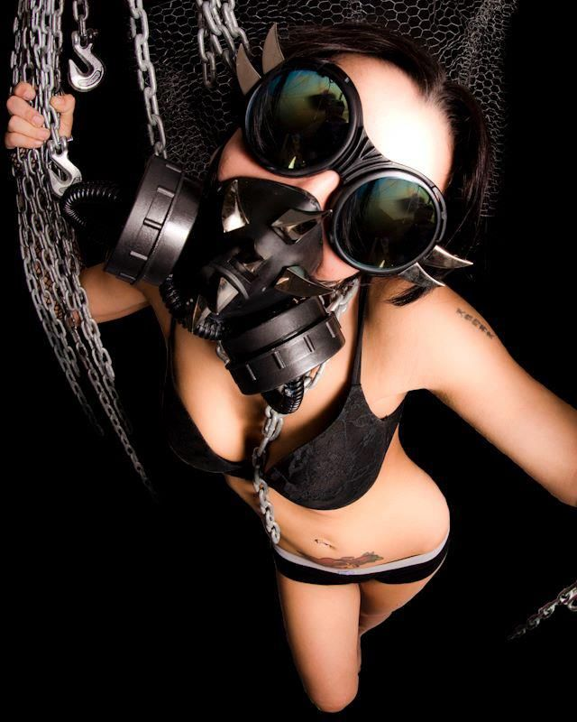 Naked girl with gas mask