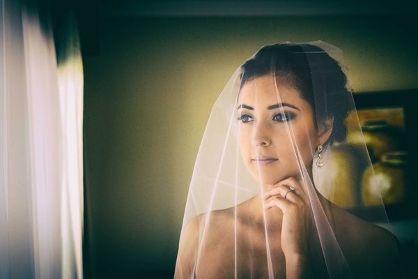 Bride with Veil Over Face | Photography: Juan Carlos Tapia Photography. Read More:  http://www.insideweddings.com/weddings/rustic-destination-wedding-with-touching-details-on-beach-in-mexico/801/