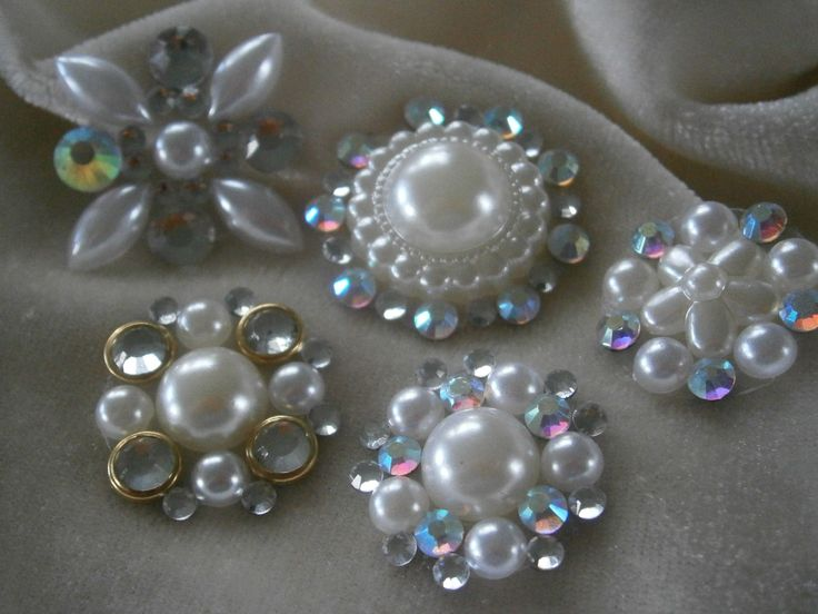 embellishment...flower centres using flatback pearls and hotfix crystals