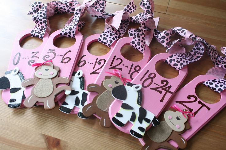 Baby Closet Dividers. I really like these but in purples and greys maybe koalas, hippos and rhinos, or grey giraffes.