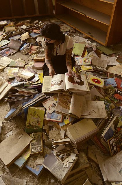 This will be how I die. Buried under a pile of fallen books. When I'm 110.