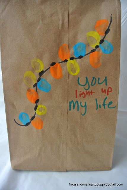 Get creative with paint to decorate these DIY Christmas gift bags with the kids!