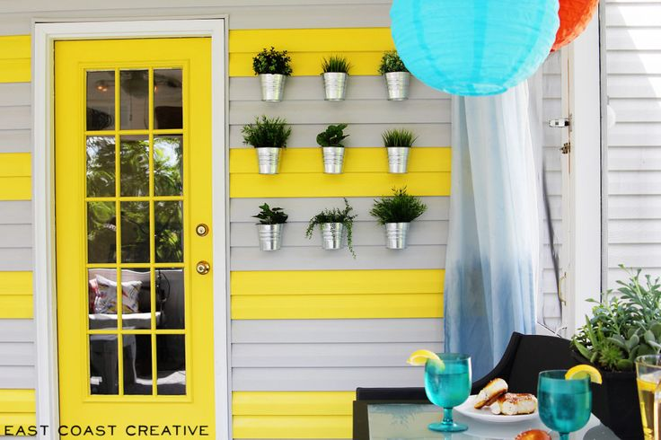 How to Paint Exterior Siding & Really Make it Awesome! - East Coast Creative Blog--Really dig the aluminum can planters.