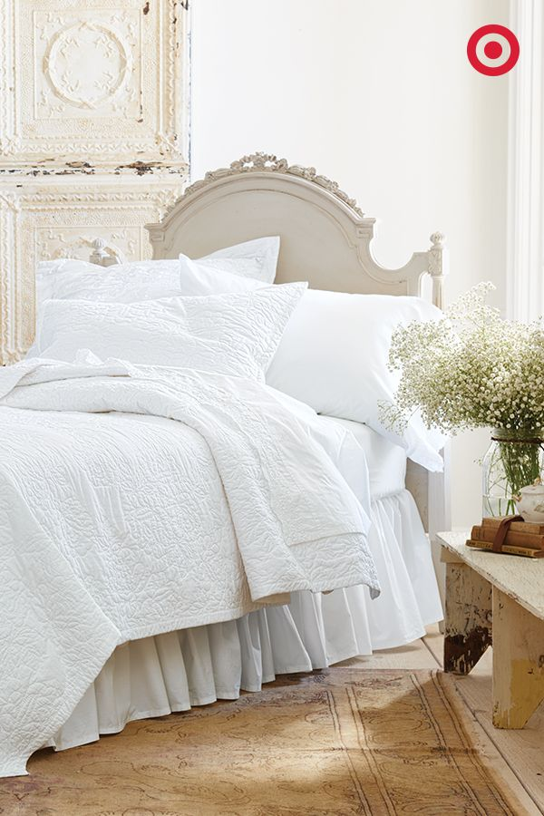 A stitched Simply Shabby Chic quilt adds soft texture to a bed, while still maintaining that room-opening canvas that only white bedding can provide. It's also the perfect backdrop for switching in bright or patterned accent pillows.