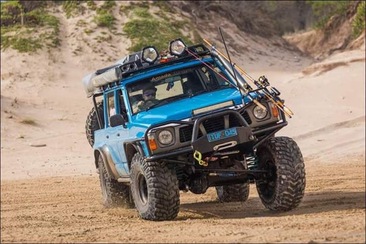 blue nissan patrol gq on sand