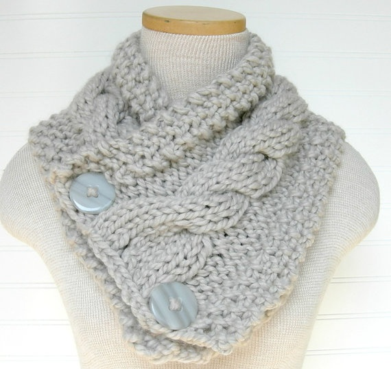 Sweater scarf with buttons.