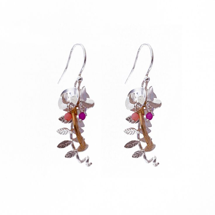 Celebrating the sweet pea, these drop earrings show flowers, leaves and a sweet pea pod. The earrings are made from solid silver with two pink beads in the centre of the flowers to channel the colour of their petals. As these earrings are made from solid silver, they can be worn on a daily basis. A great gift for someone with green fingers or a loved one who adores nature.