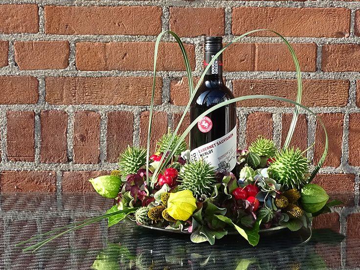 Een heerlijke wijn met een mooie bloemcreatie; wat een feest!