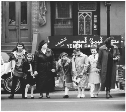 These Arab American family members are standing in front of the Yemen Caf in Brooklyn, New York. Many Arab Americans live within an  Arabized subculture that has enabled them to maintain their distinct ethnic culture.