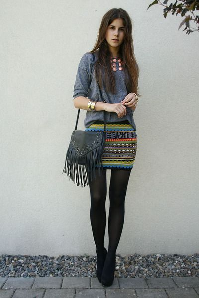 GET YOUR AZTEC SKIRTS ON -- everything about this outfit rocks, the skirt, the tights and black shoes, the fringe, and the pop of pastel on the necklace.