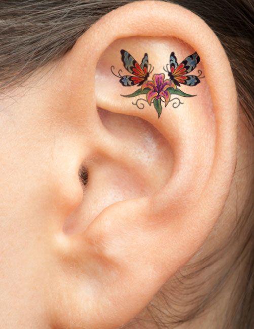Two Butterflies On Flower Ear Tattoo #TattooModels #tattoo