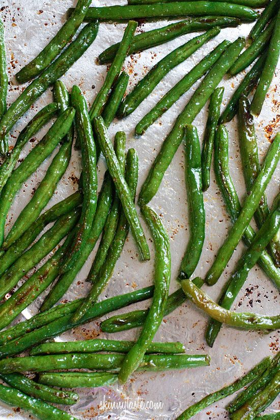 green beans + olive oil + salt +pepper + garlic powder +parmesan. 425 degrees for 10 min. shake. then another 5 min.add parm cheese. Yum!