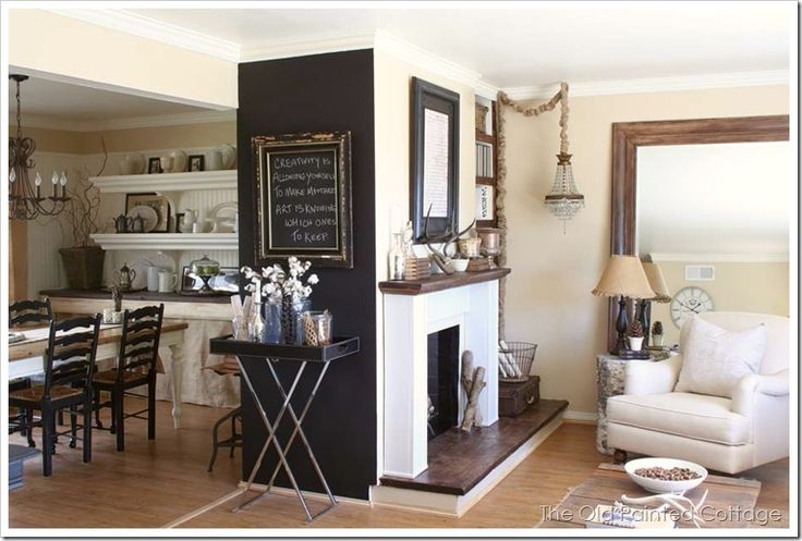 Rustic dining room, half open to the living room, black accent wall goes well wi
