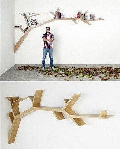 Branch of a tree bookshelf. I love this.
