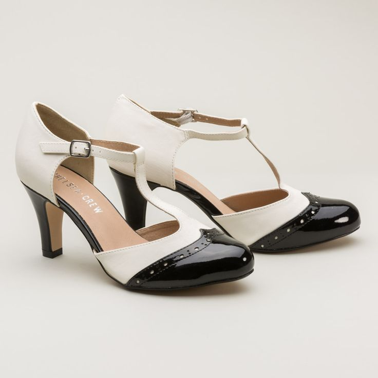 Dance a mile or two at your 1920s flapper-themed party in our iconic Gatsby two-tone t-straps. Gatsby features patent leather brogue detail on matte leather, adjustable buckle closure, and a 3