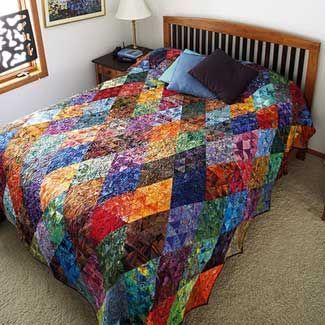Thousand Pyramids Quilt by Shon McMain Pull batiks from your stash to make this dynamic quilt.