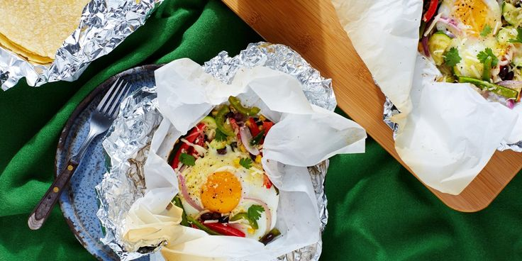 These make-ahead packs are perfect for camping trips as well as quick and easy breakfasts on the go. The Mexican-inspired ingredients are topped with baked eggs and served with tortillas for a hearty morning meal.