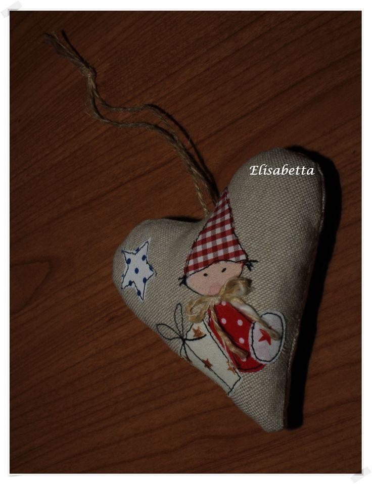 cuore con applicazioni Natale
